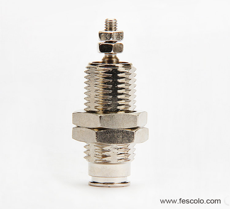 Spring return needle cylinder